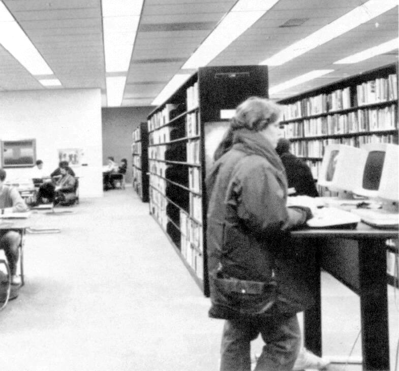 Inside the library, a youngster uses the computerized card catalog system. Photo by Milton Nidetz