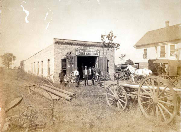 The Lohrke Bros. blacksmith shop on Niles Center Road just north of St. Peter's Catholic Church about 1902