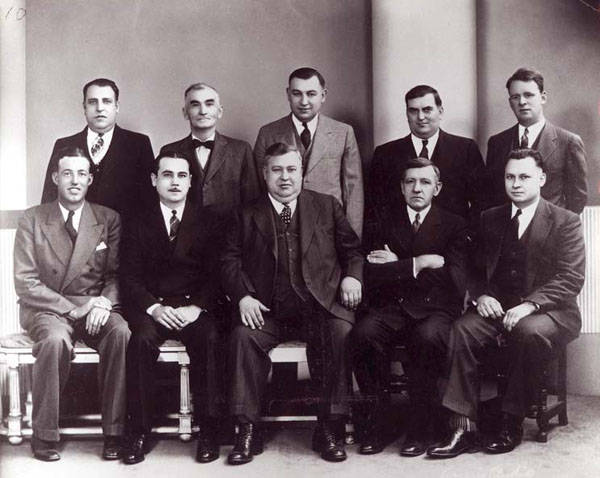"The Luxembourg Brotherhood of America's Section15, founded in Niles Centre in 1905, is the oldest civic or fraternal organization still in existence in Skokie.  Shown here are officers of the section in 1938, left to right:  seated, Nick Kalmes, Pat Seul, Martin ""Scotty"" Krier, Paul Hermes, Joseph Freres; standing, Anton Krier, Jr., Anton ""Tony"" Seul, Val Krier, Bill Biegert, Sr., Adam Hohs."