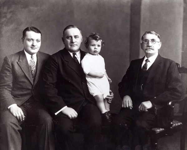 Four generations of the Busscher family, which was instrumental in the development of business in Niles Centre:  left to right:  George, III; George, Jr.; George D; George, Sr