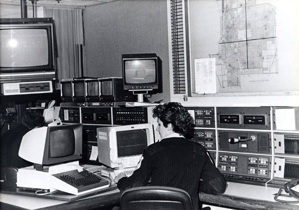 The modern Skokie Central Dispatch in action.  A telecommunicator attends to the elaborately modern communications set-up which serves the police and fire departments.